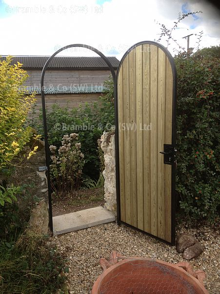 Electric gates small wooden